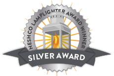 Silver award badge that says NESHCO Lamplighter Award Winner SILVER AWARD
